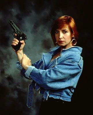Cynthia Rothrock gun pose