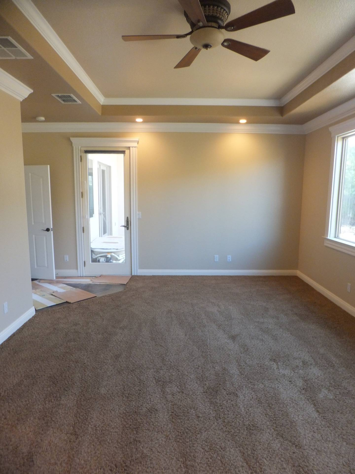 Master Bedroom with Custom Made Ceiling Soffit and Double Stacked Crown Molding
