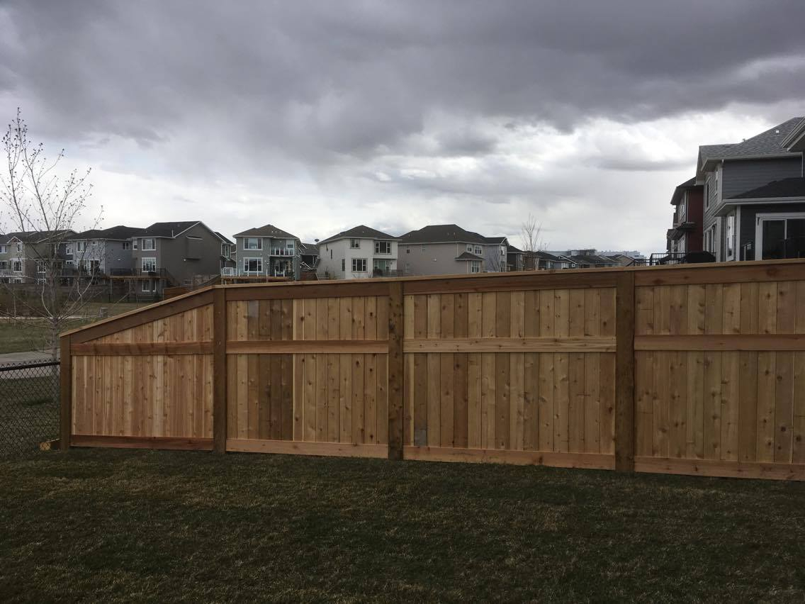 cedar fence with brown pressure treated post