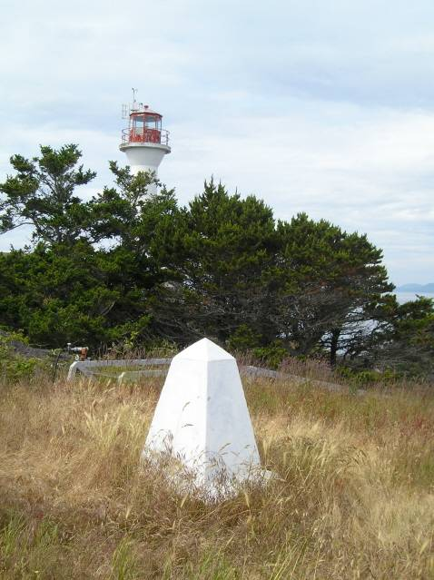 US - Canada border turning point marker at the Discovery Island Lighthouse.