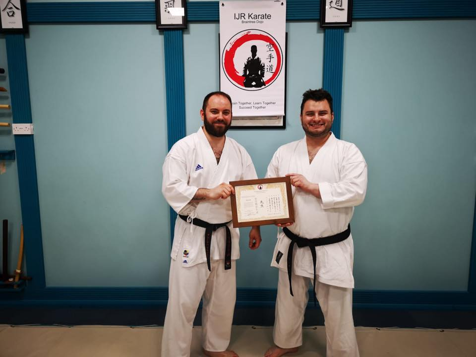 Sensei award Sensei Richy with his award