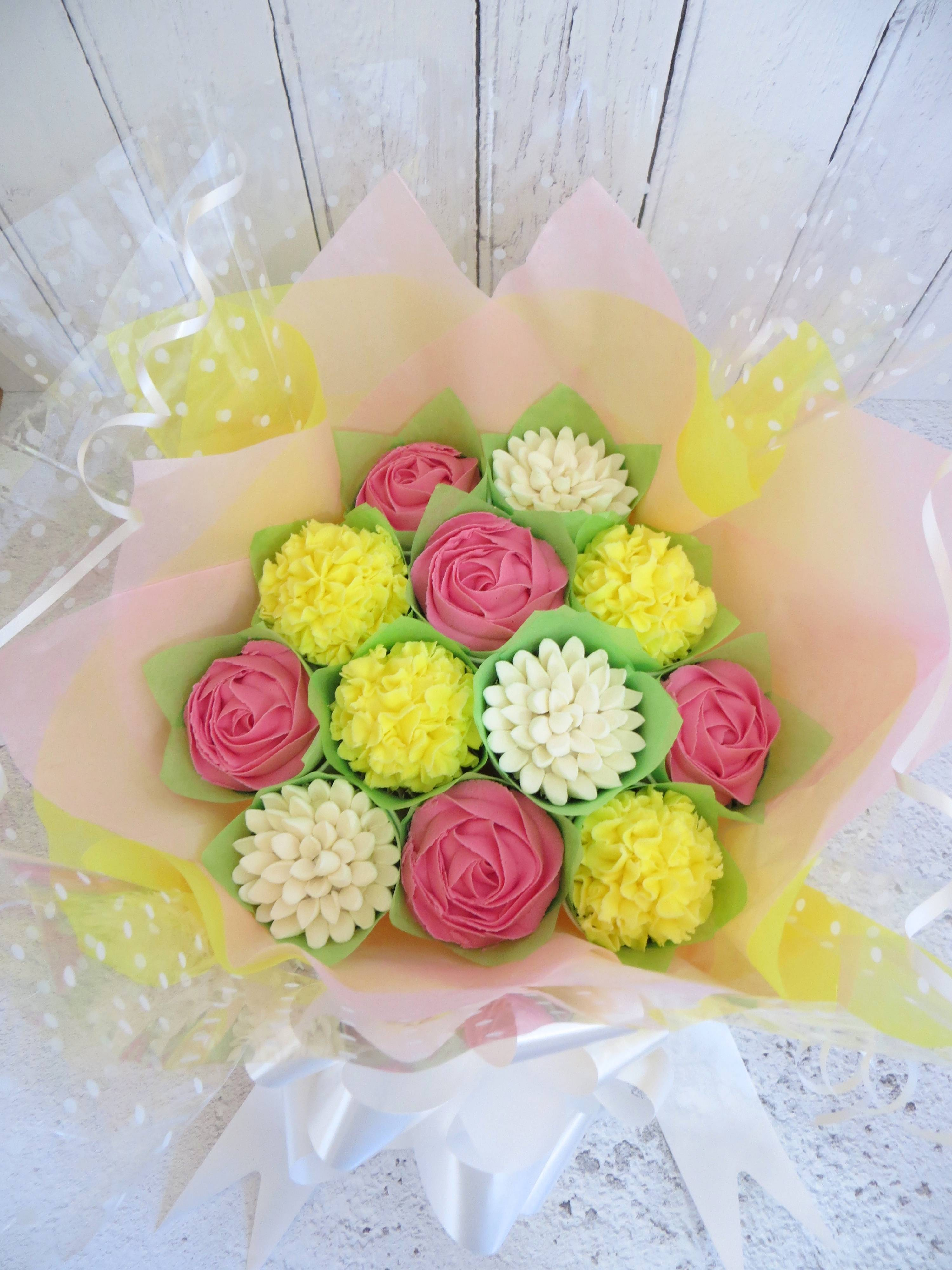 Pink, yellow and white cupcake bouquet