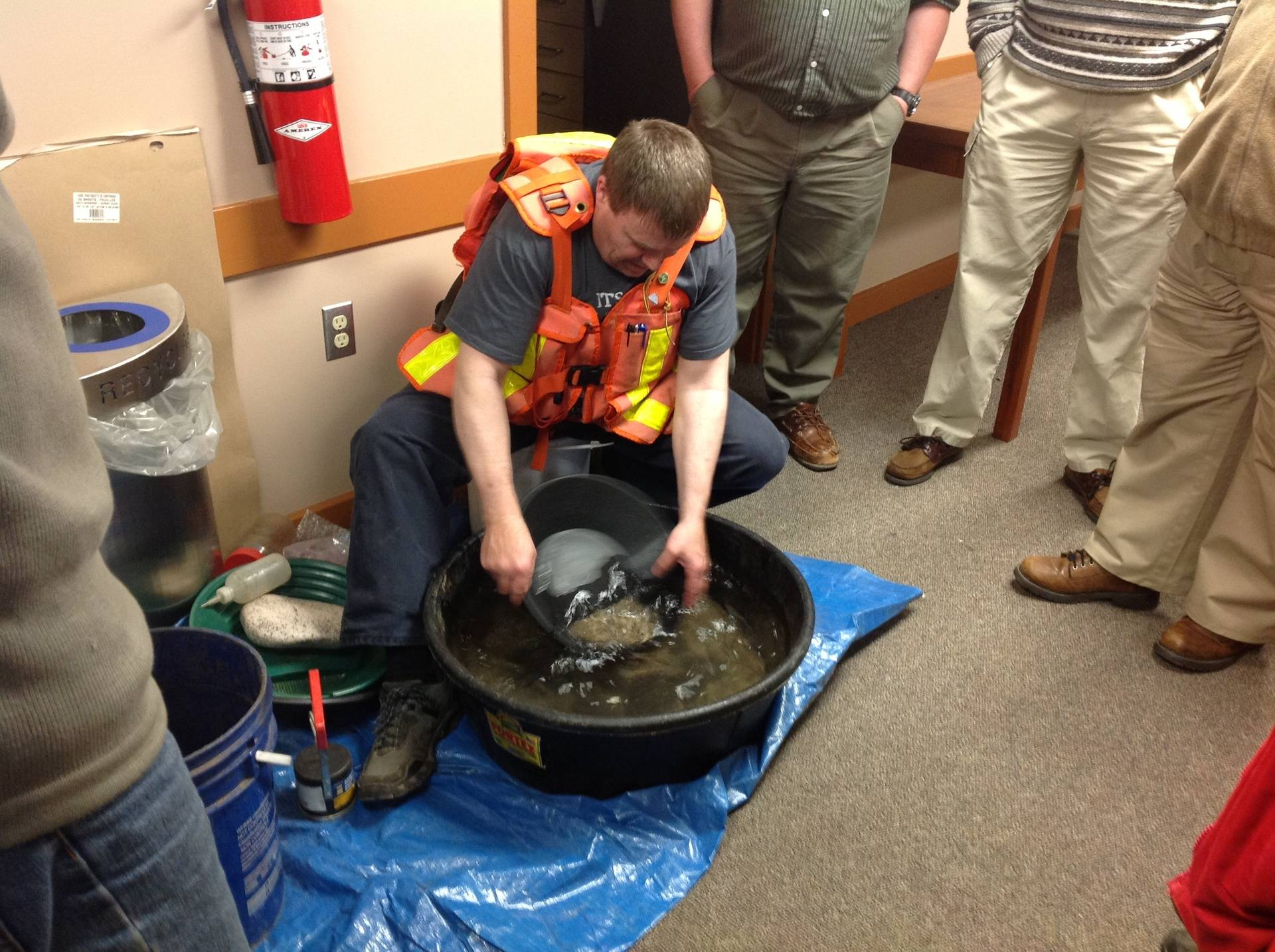 Fred demonstrates gold panning, a traditional and tried-and-true method of recovering gold