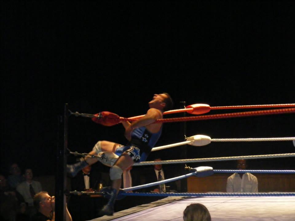 Ritchie falls through ropes
