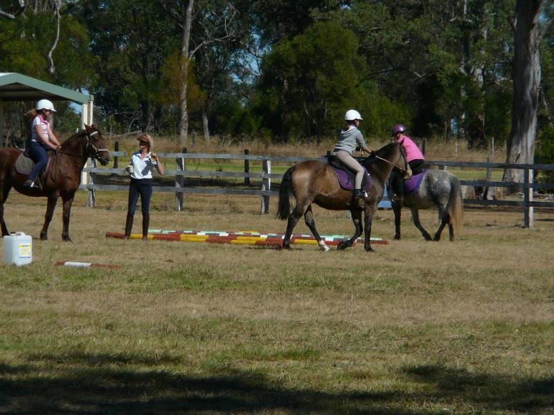 Clare & Vincie doing trot poles