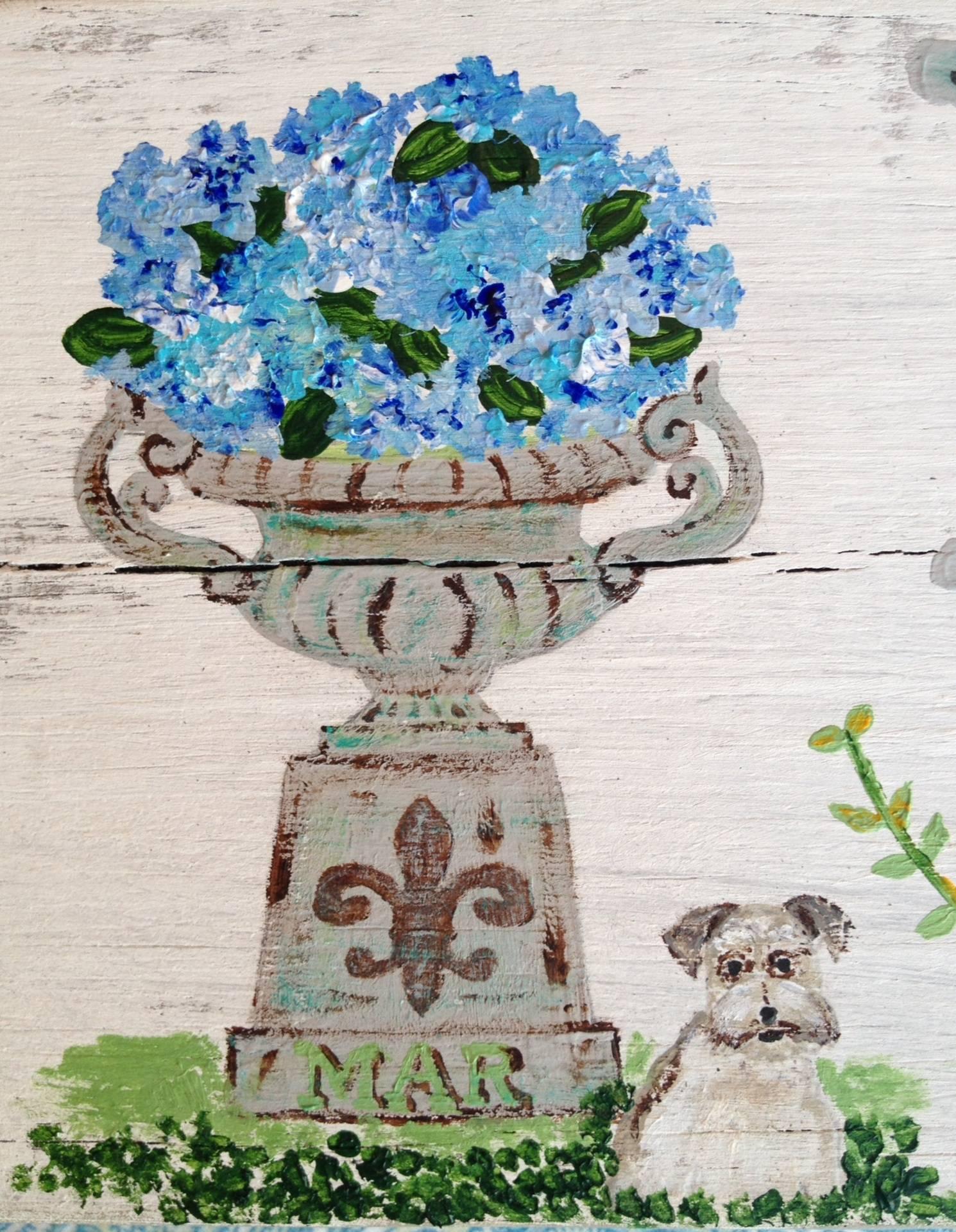 Hydrangea blooms in an antique urn