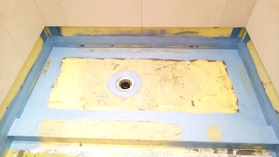Wet room shower tray waterproofed