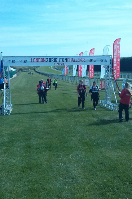 Lucy crossing the finishing line