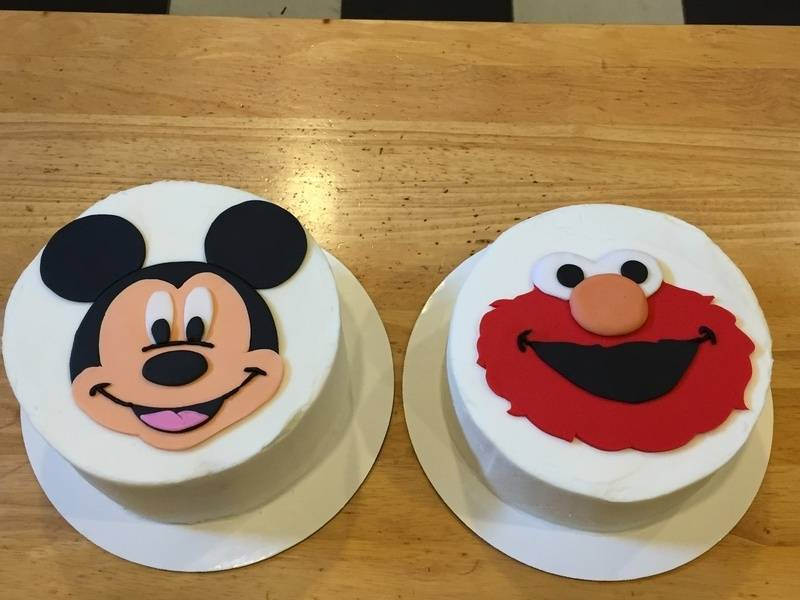 Twins' Mickey and Elmo cakes