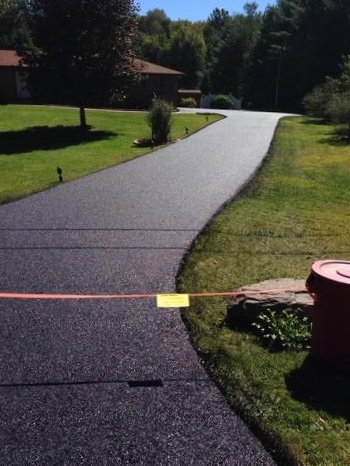 New asphalt driveway construction