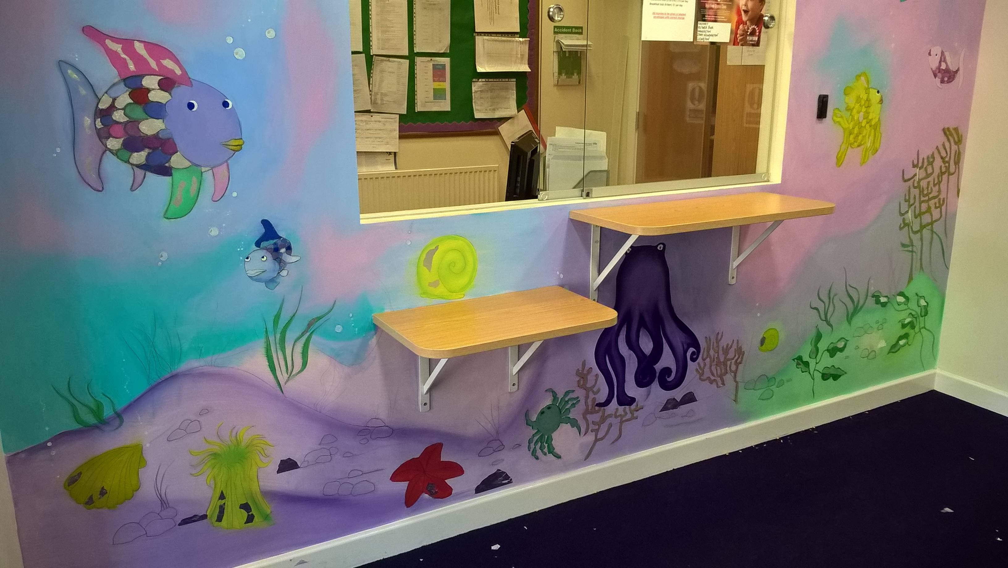 Office reception area. Rainbow fish