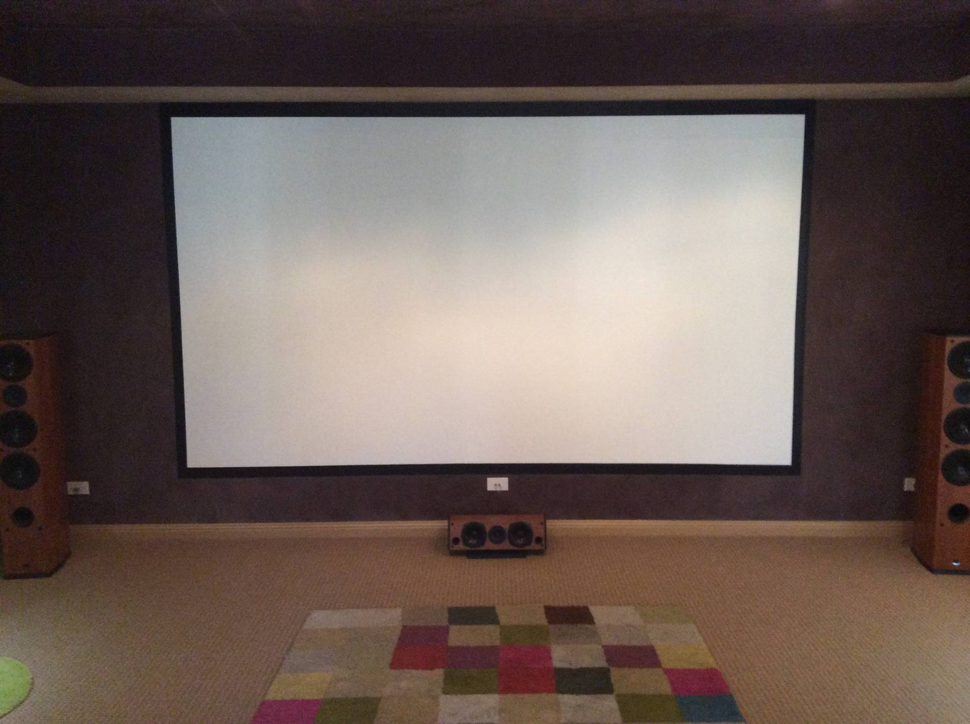 Painted cinema screen and suede ceiling