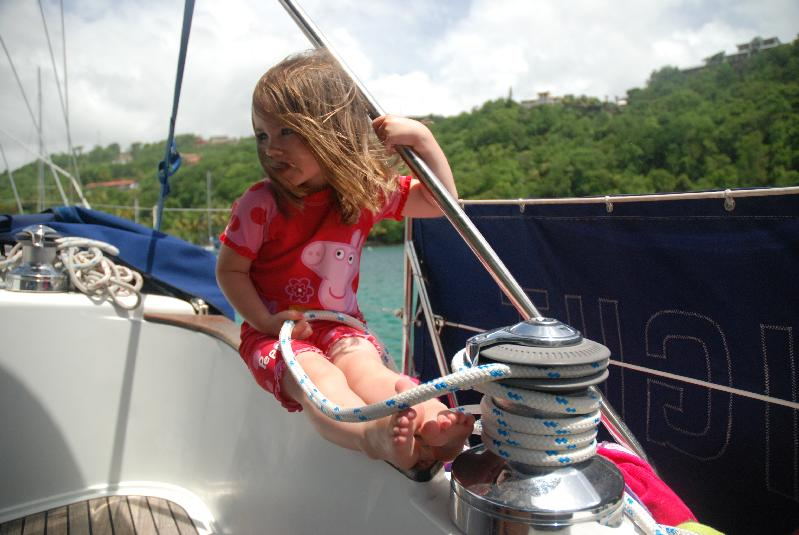 Phoebe pulling in the gib sheet (at anchor!)