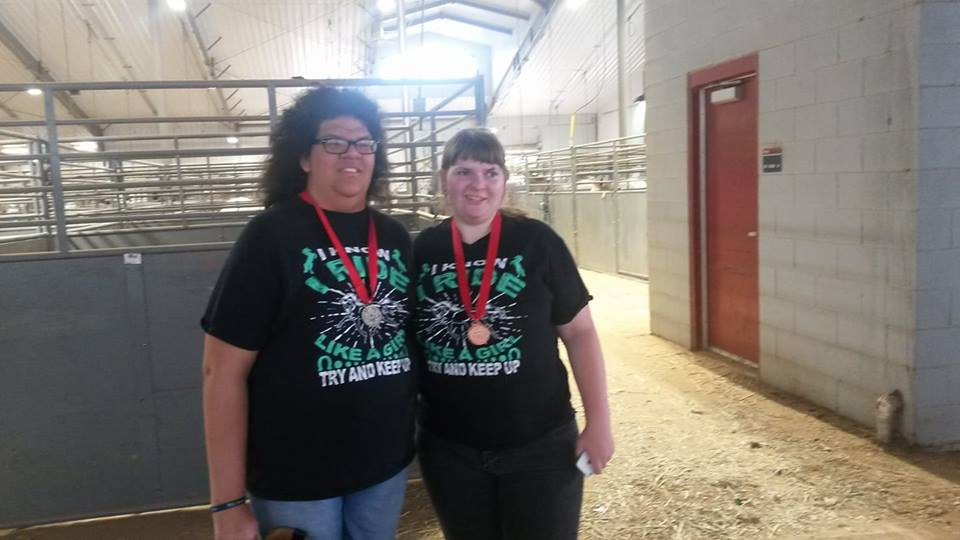 Anna and Lydia showing off their medals