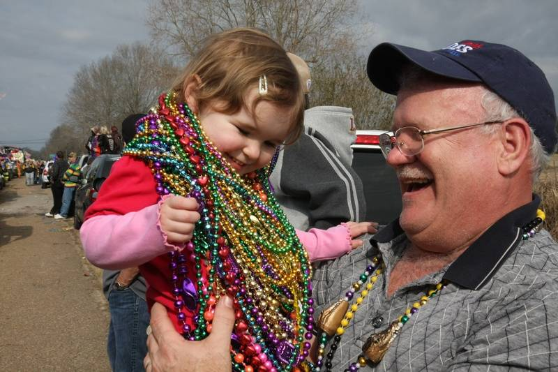 Getting beads at the Chicken Run Parade