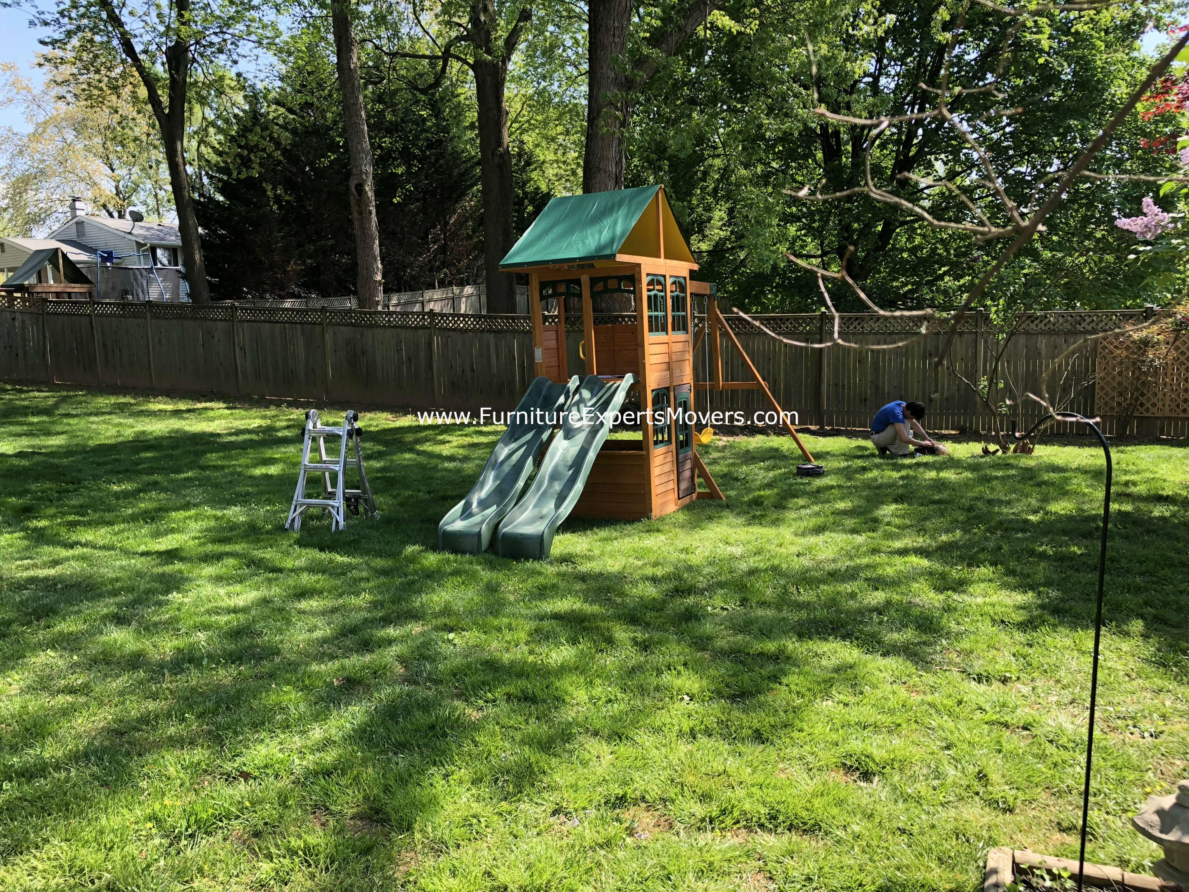 big backyard treasure trove swing set installation in germantown MD