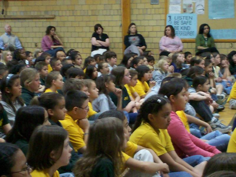 Students at Goodnight Elementary in Pueblo listen to the Chorale