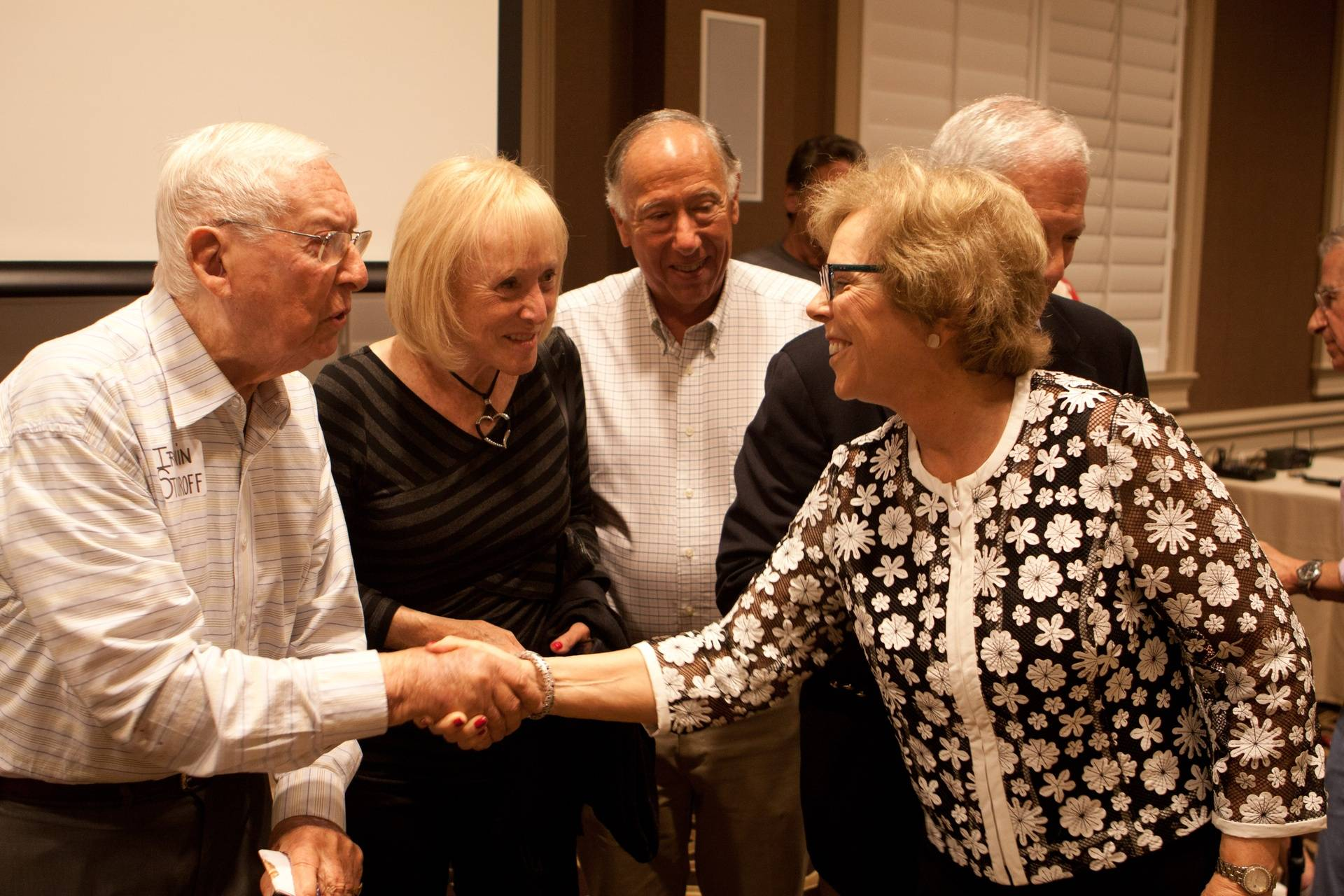 Co-producer Nancy-Jo Feinberg greeting Irwin Stovroff as Lois and Bob Hendricks look on