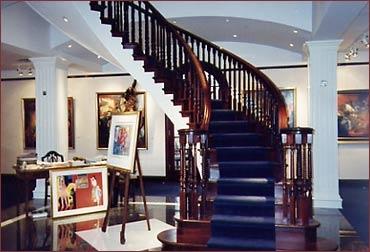 Escalier bois, cintré, Barreaux torsadés, Acajou