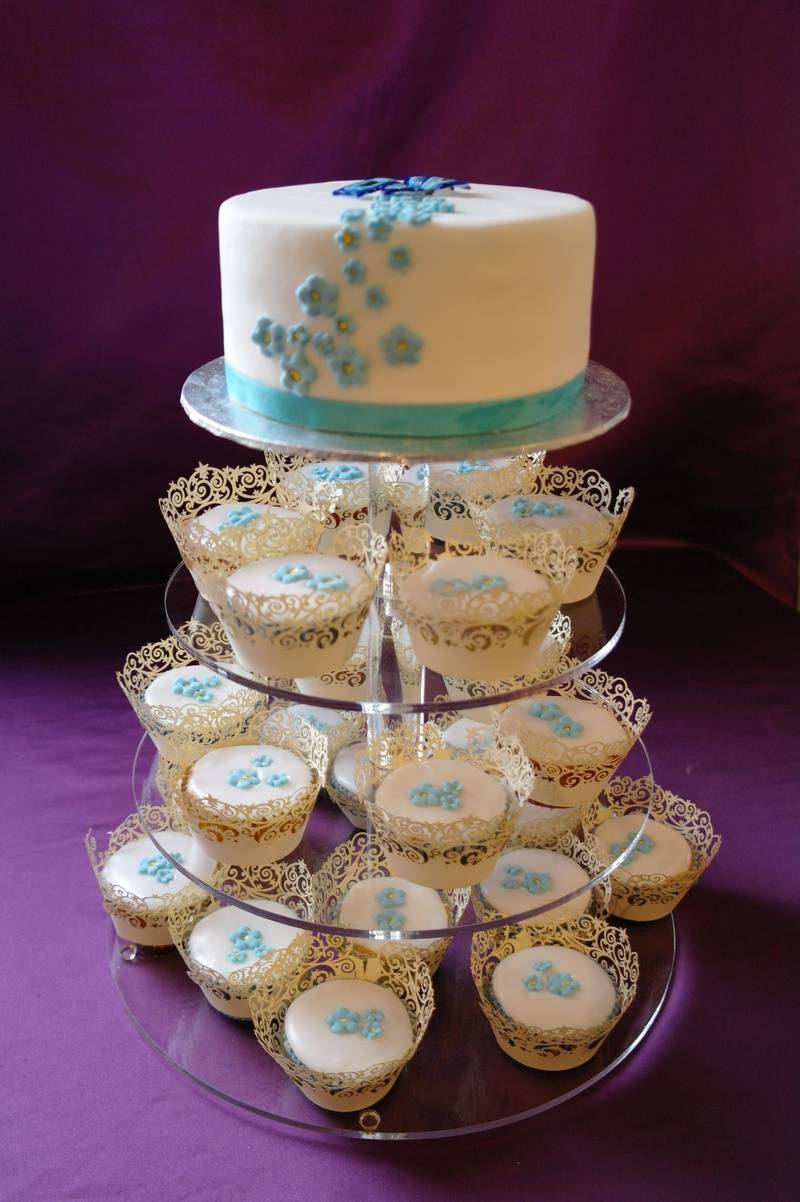 blue flower wedding cake and cupcakes