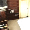 TV and shelving unit which holds the tea and coffee the microwave,