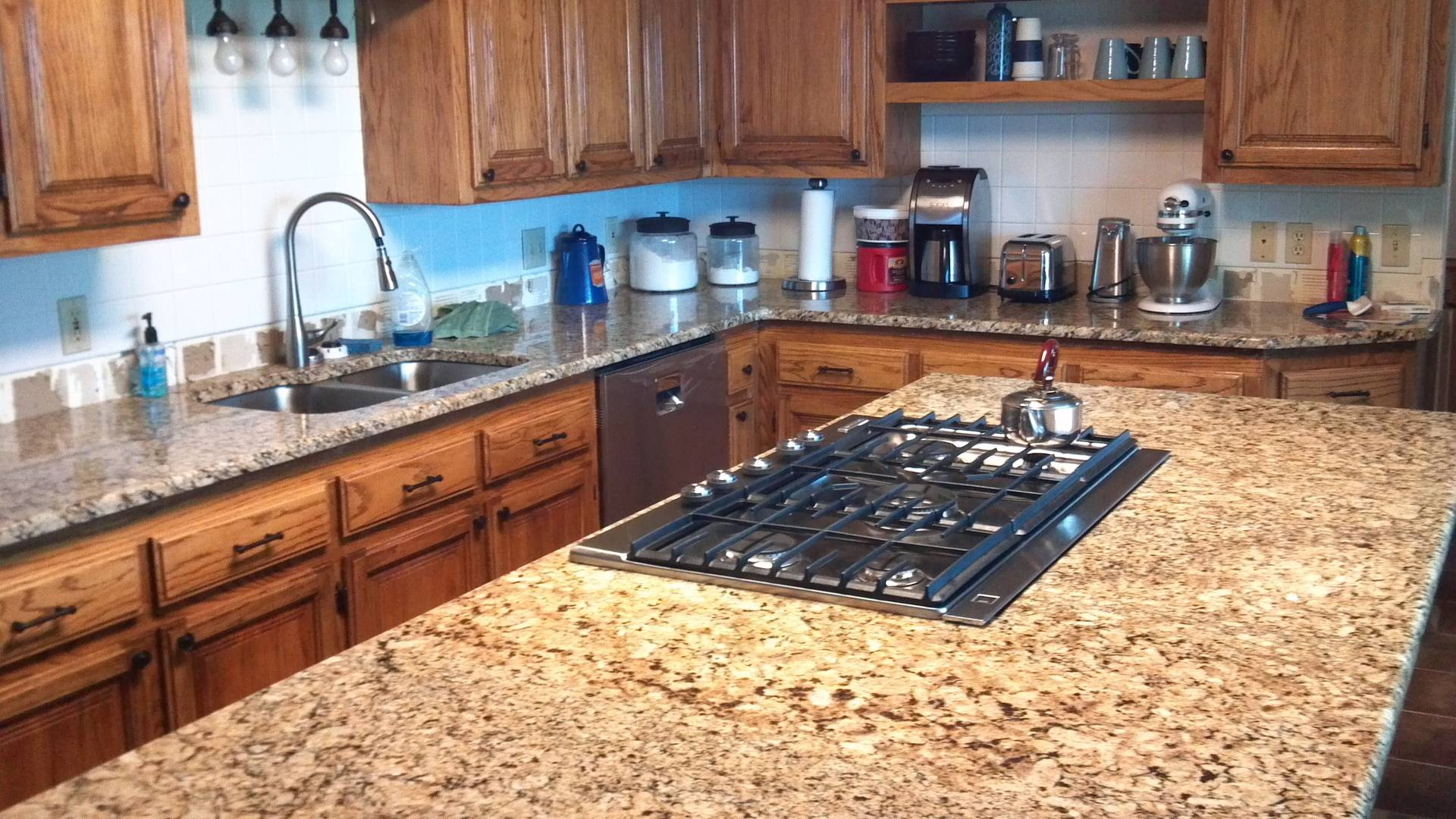 New Granite Counters and Modern Cooktop