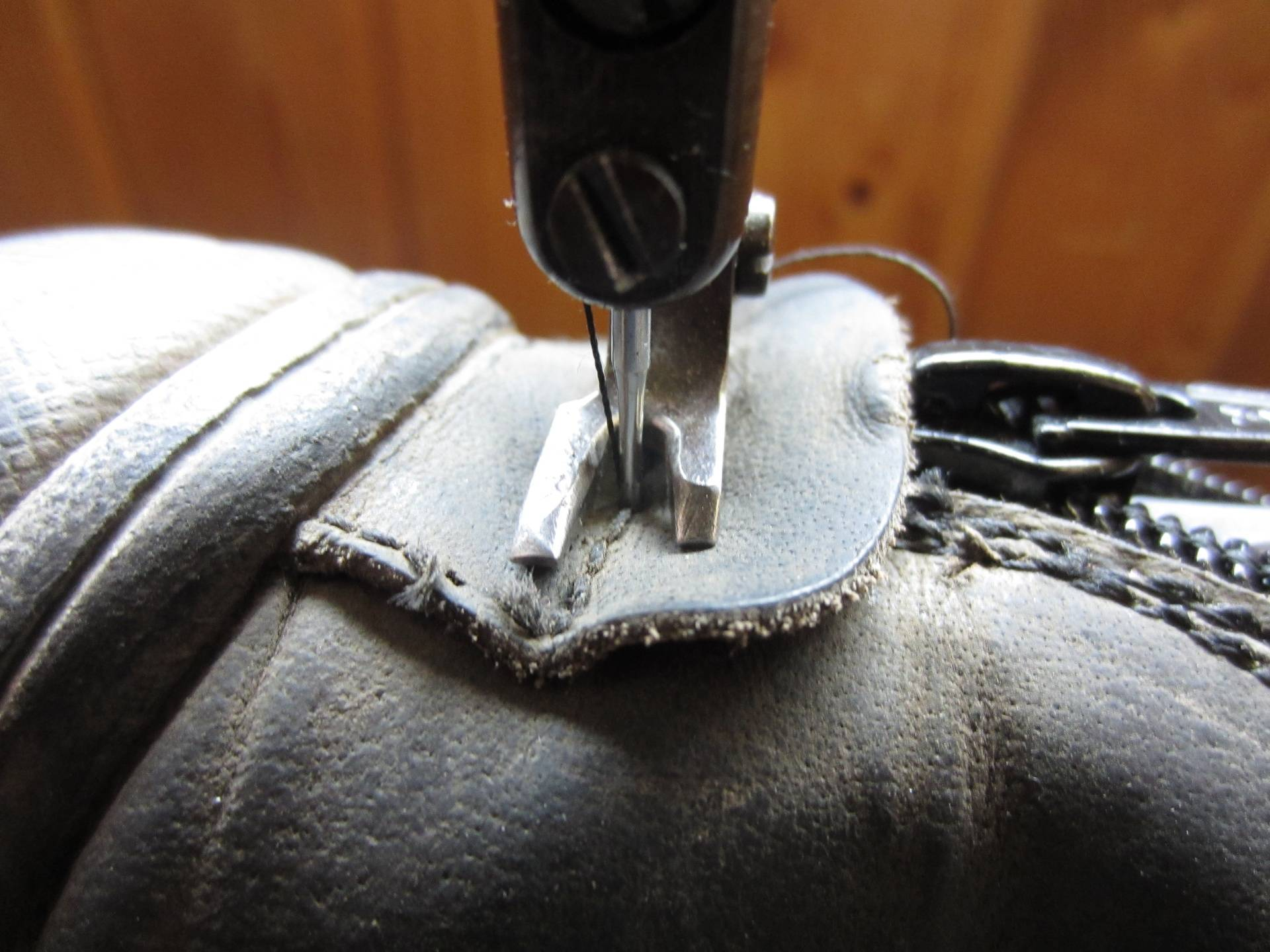Stitch bottom tab and then stitch the restof zip int boot