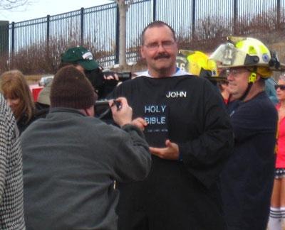 Pastor Johmn being interviewed
