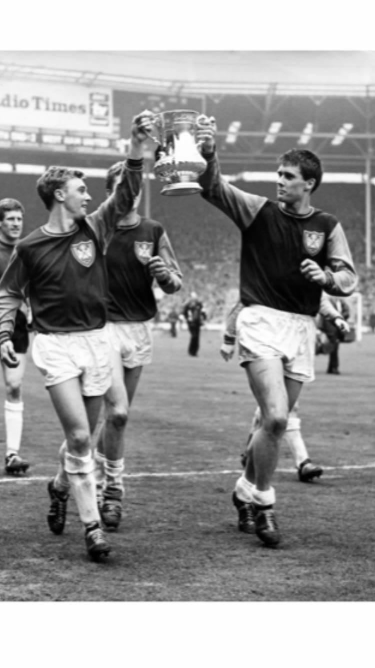 Goal scorers John Sissons and Geoff Hurst.