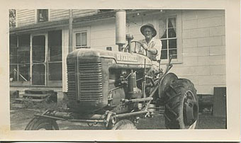 George Lafayette Squires and Farmall Tractor