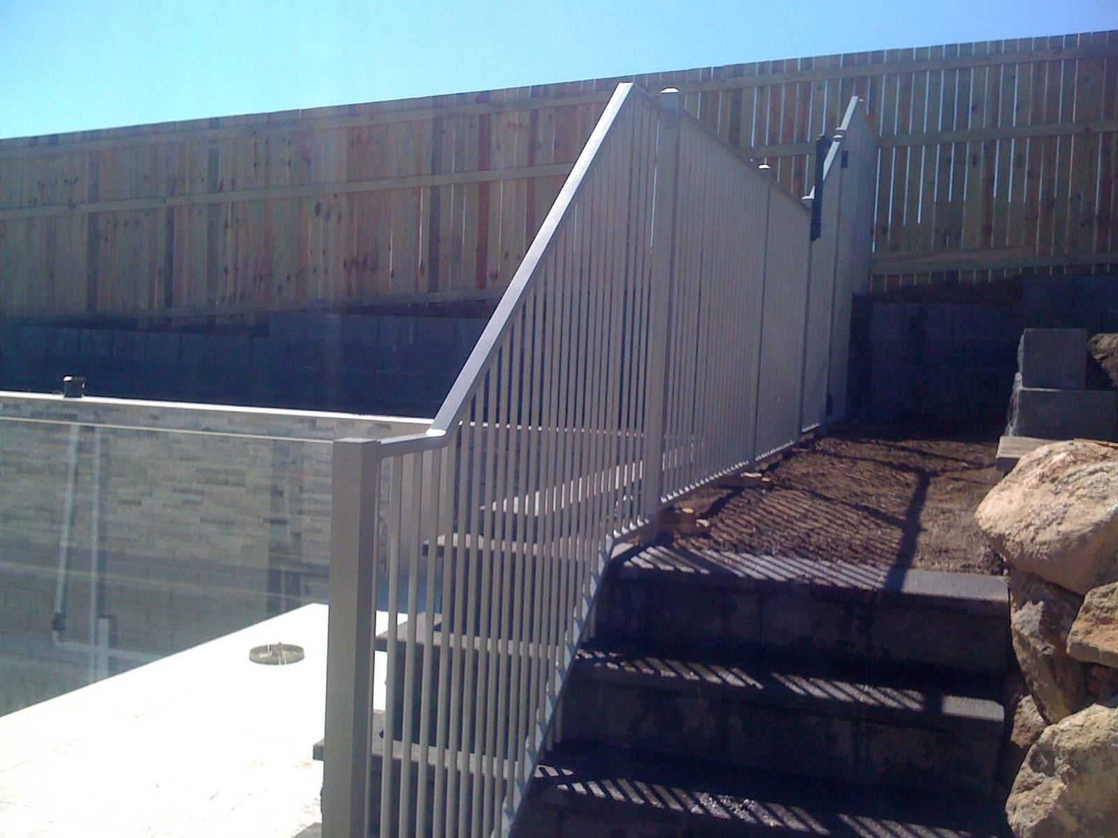 Pool fencing up and over stairs.