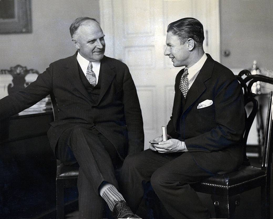 Charles showing President Calvin Coolidge his medal