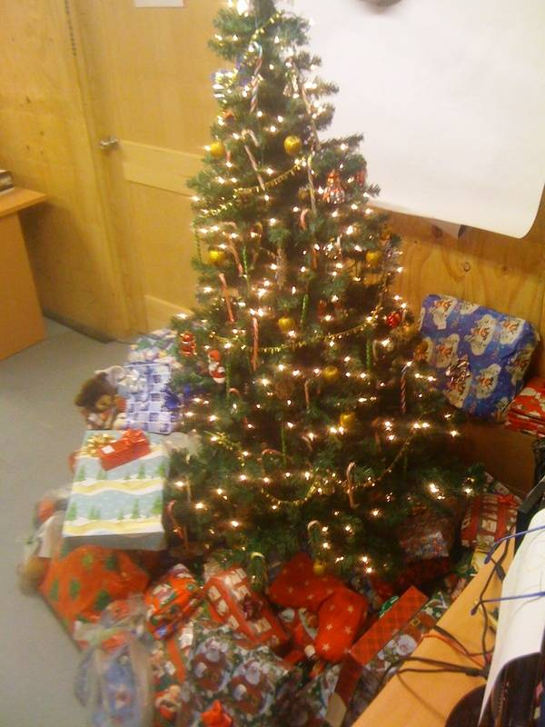 Gy Sgt Thomas Conklin ,Marine with their tree and gifts from ASWL