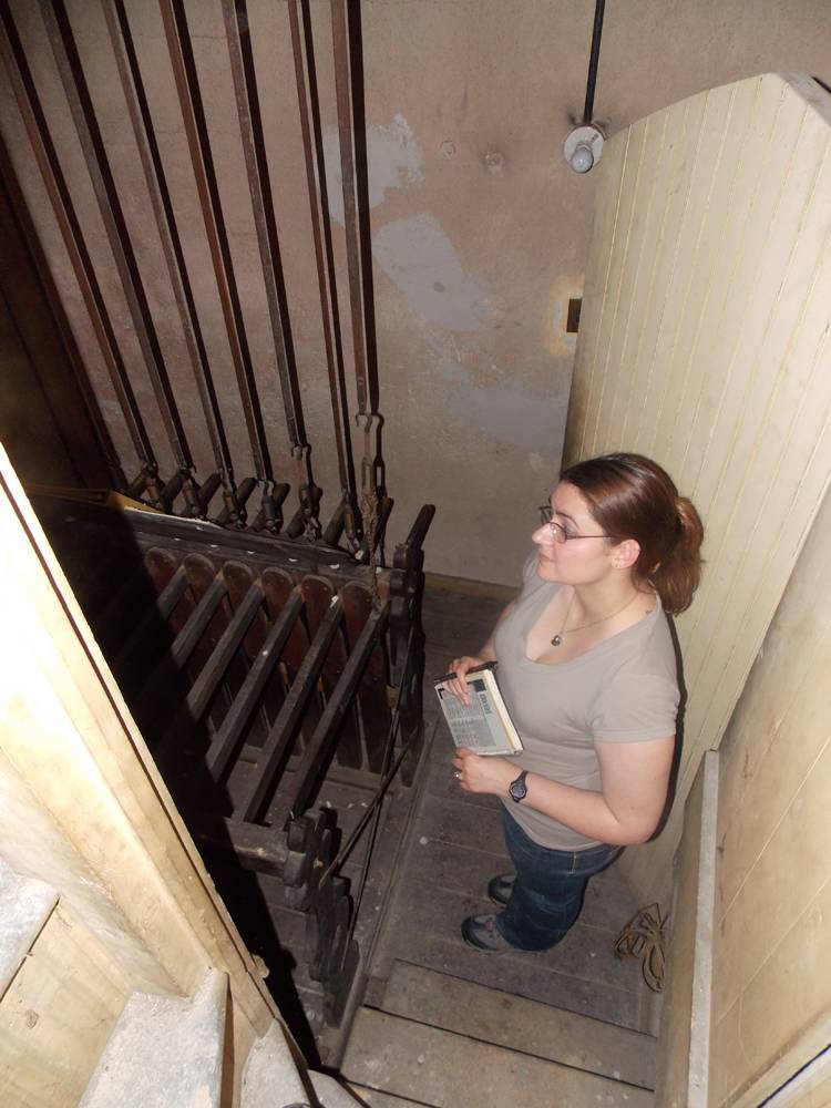 Jen in the lower area of the bell tower