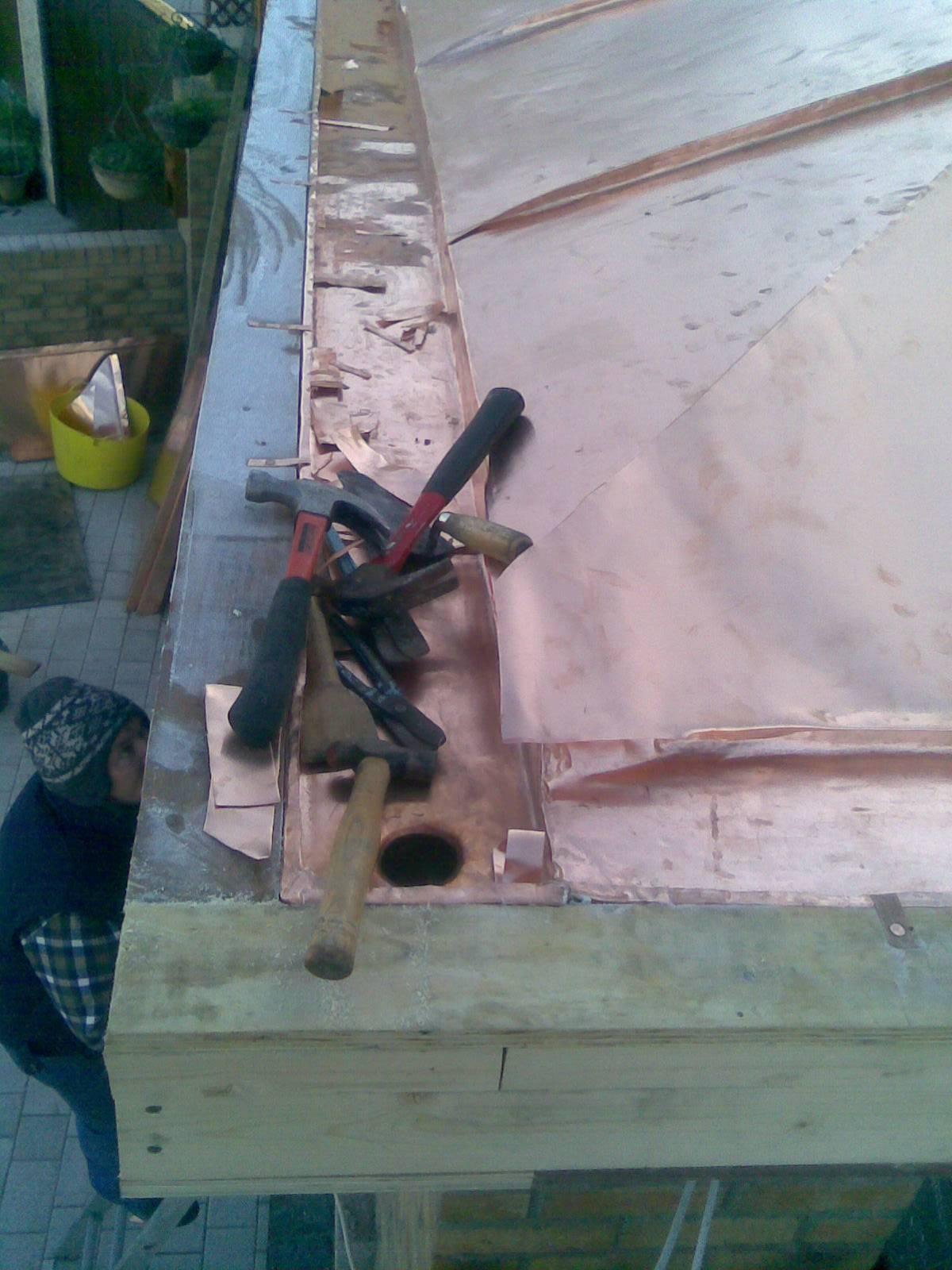 Secret copper gutter to porch