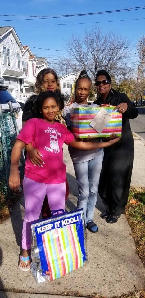 Happy family receiving donation