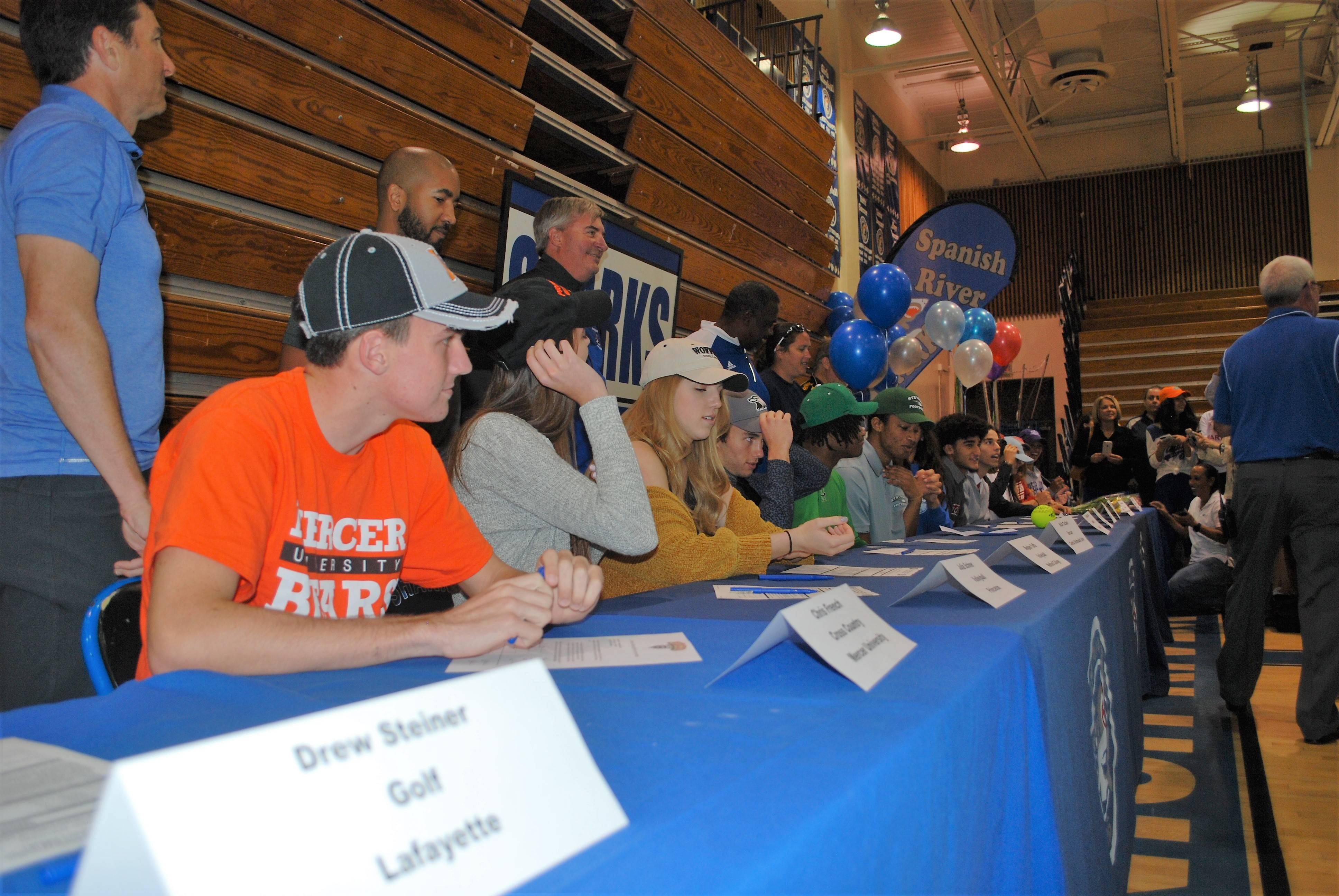 Seniors Sign to Their College Sports Teams