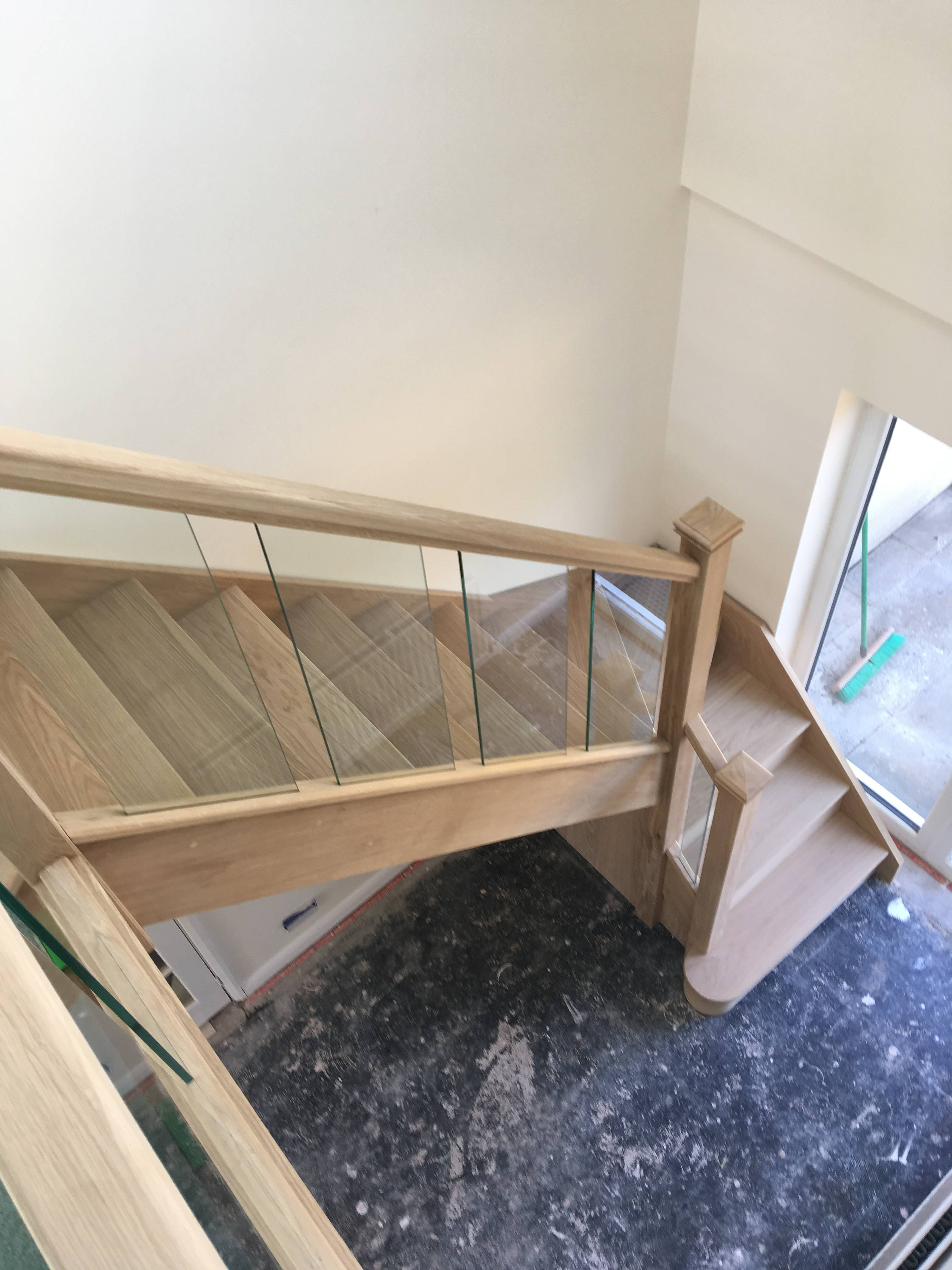 Oak staircase with toughened glass.