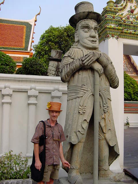 Foreigner with statue in Bangkok