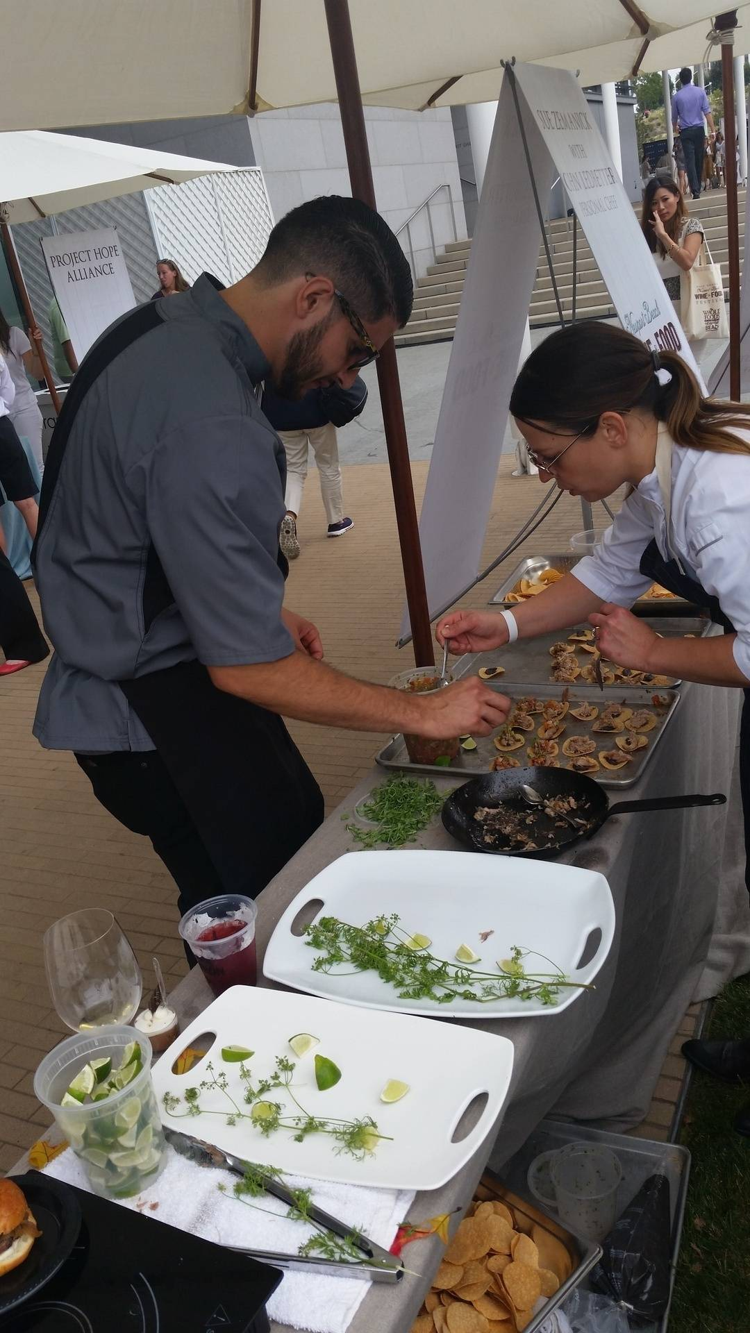 Andrew and Chef Sue platting some Carnitas Tosatads