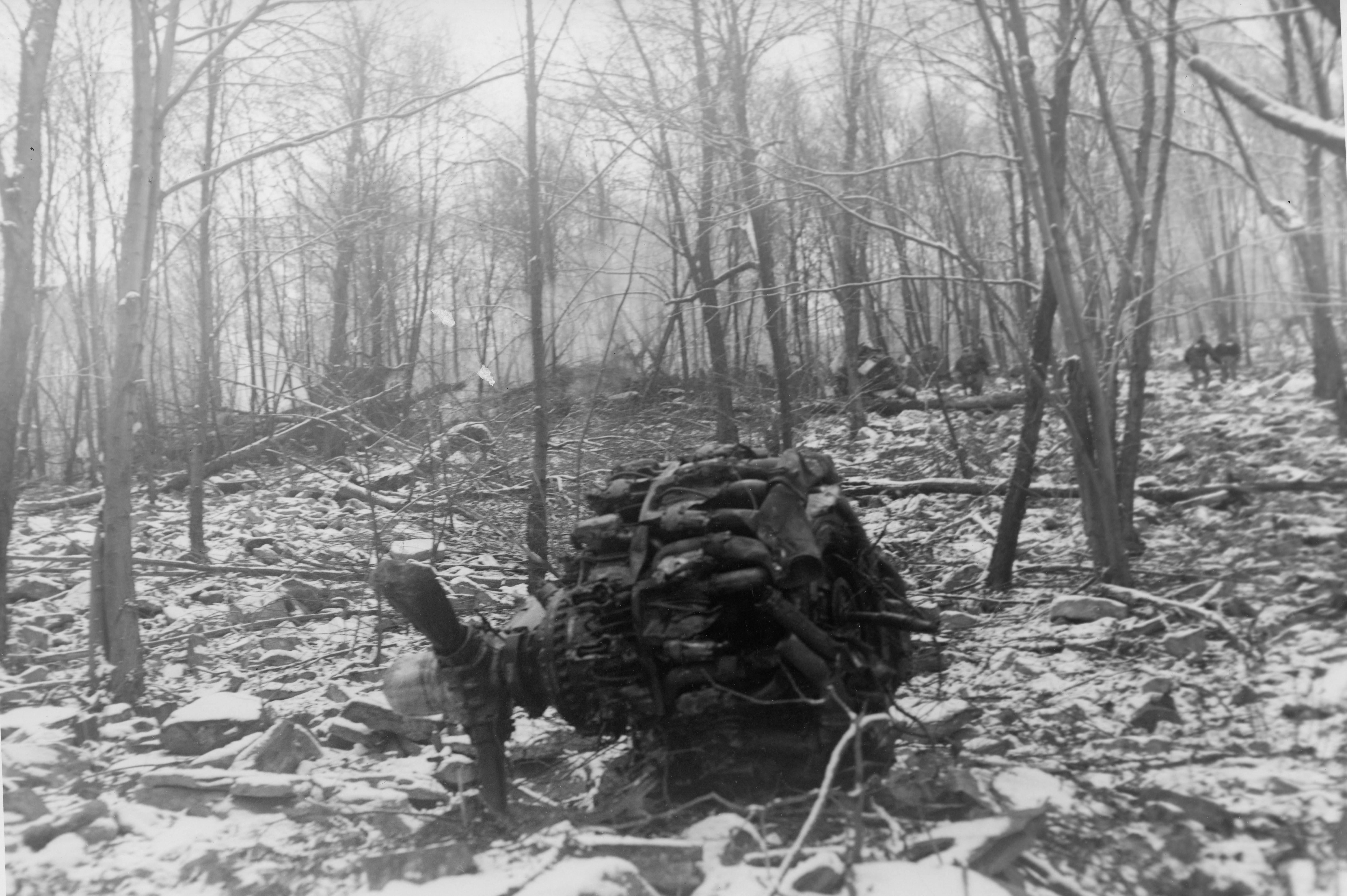 Engine laying below crash site. Photo courtesy of the Williamsport Sun Gazette archive.