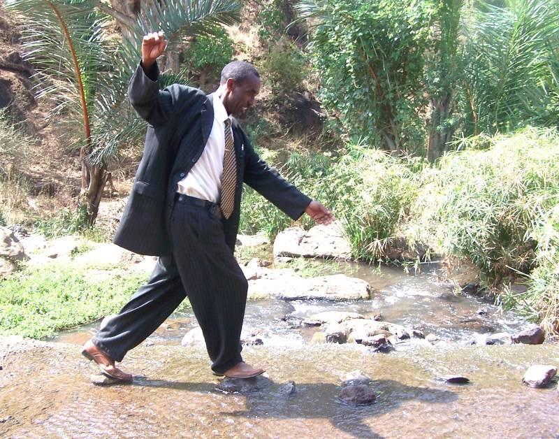 Pastor Johnson walking on the water.