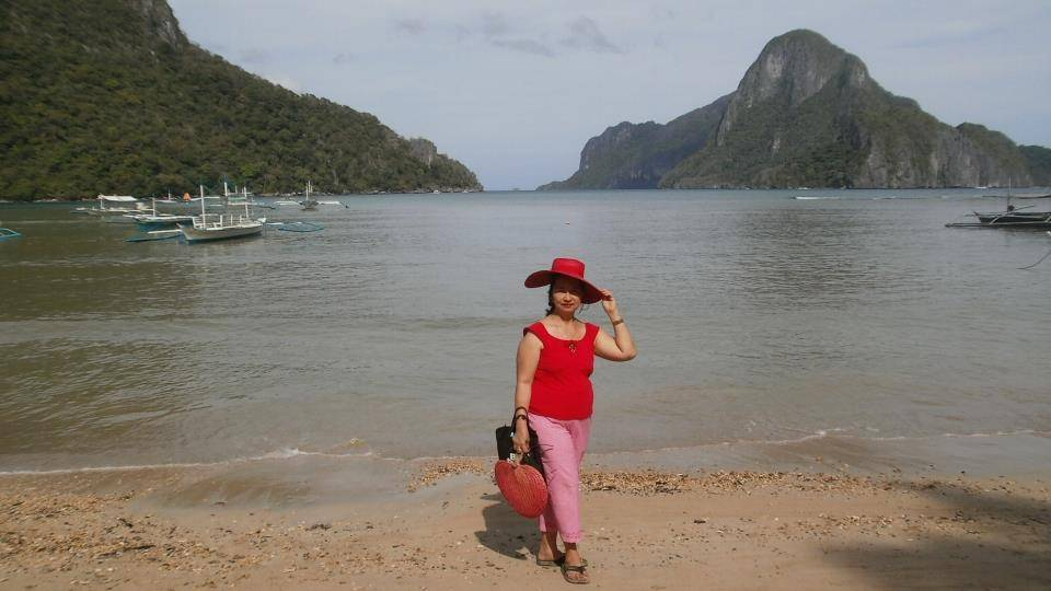 At the beach in town, facing Cadlao Island