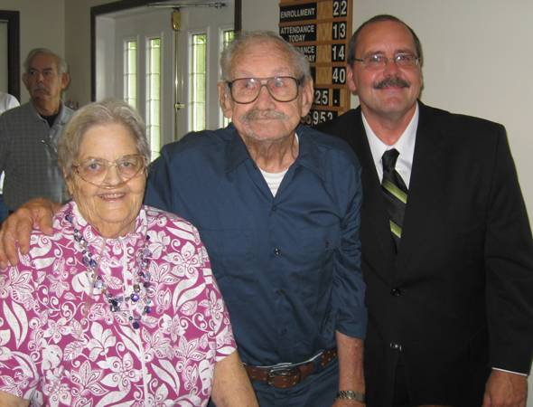 Pastor John Thacker and his parents