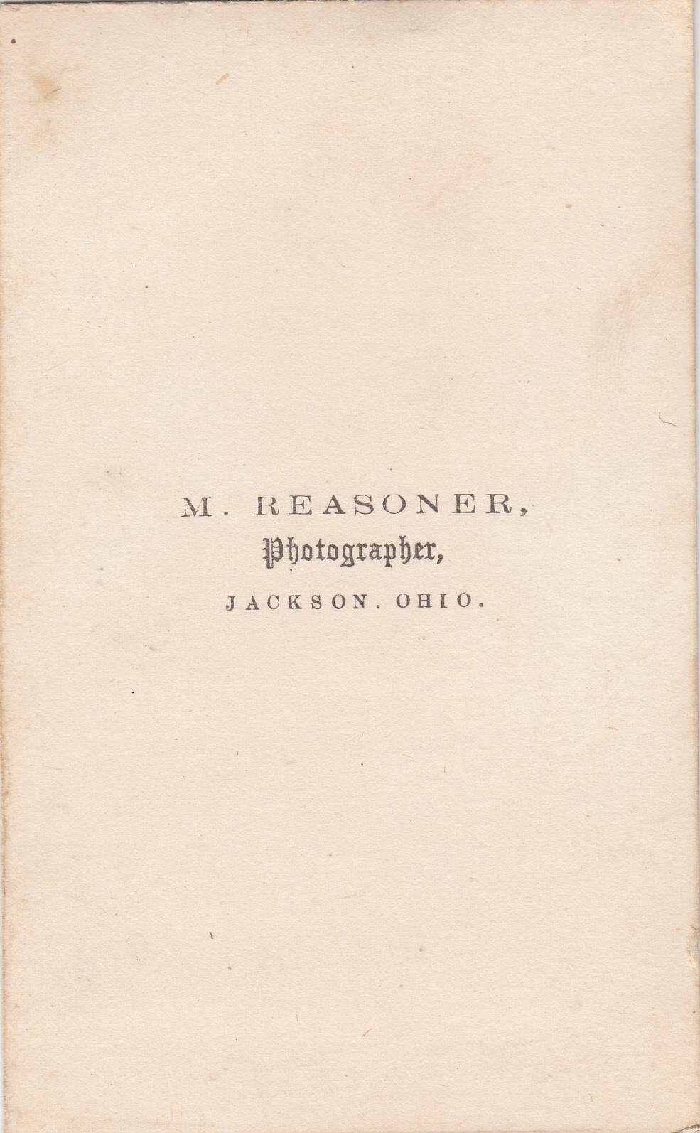 M. Reasoner, photographer of Jackson, OH - back