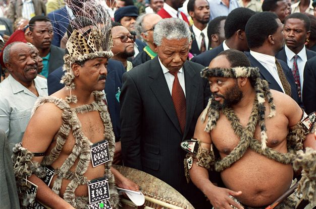 Mandela with Zuma in traditional clothes