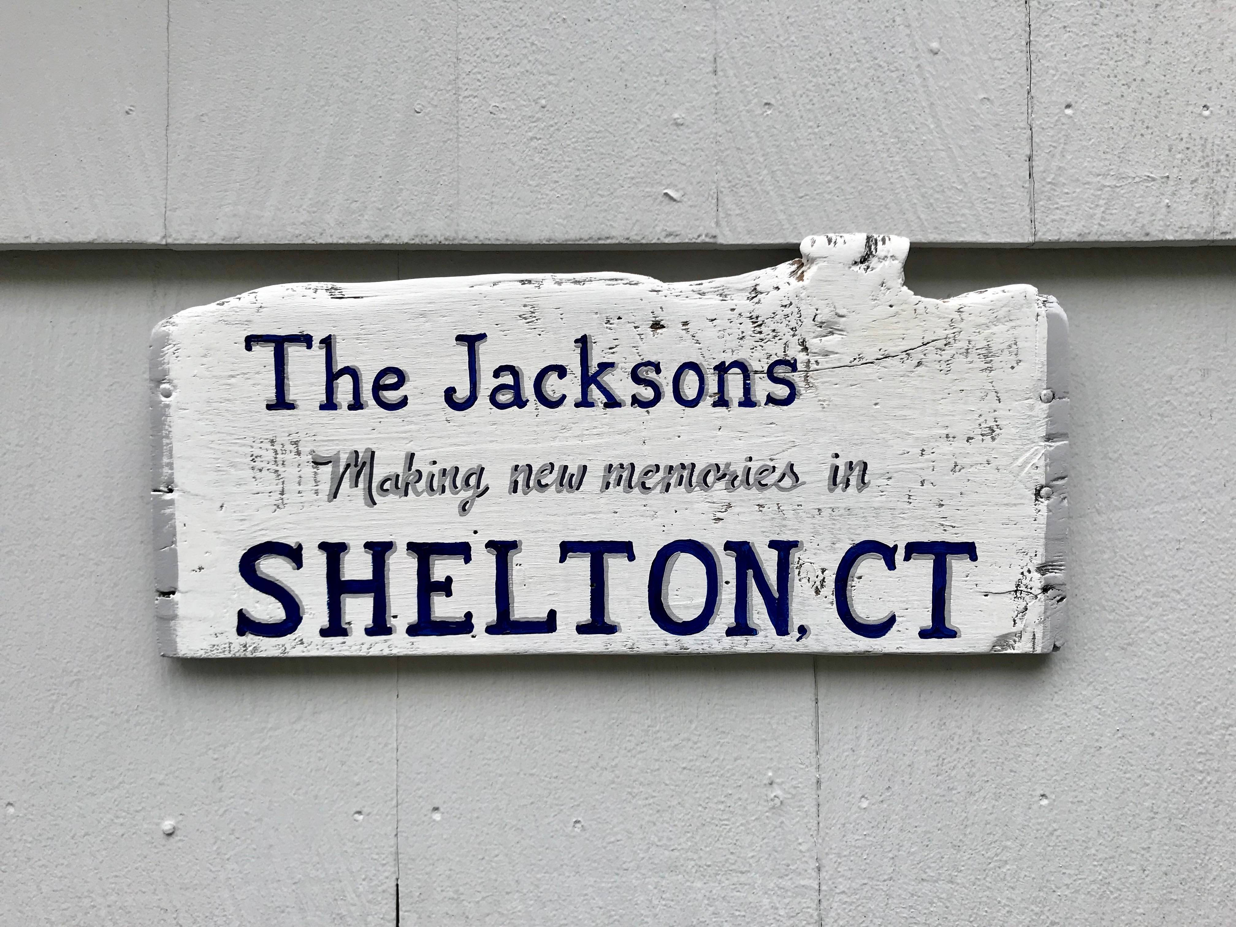 Last name and Town name sign