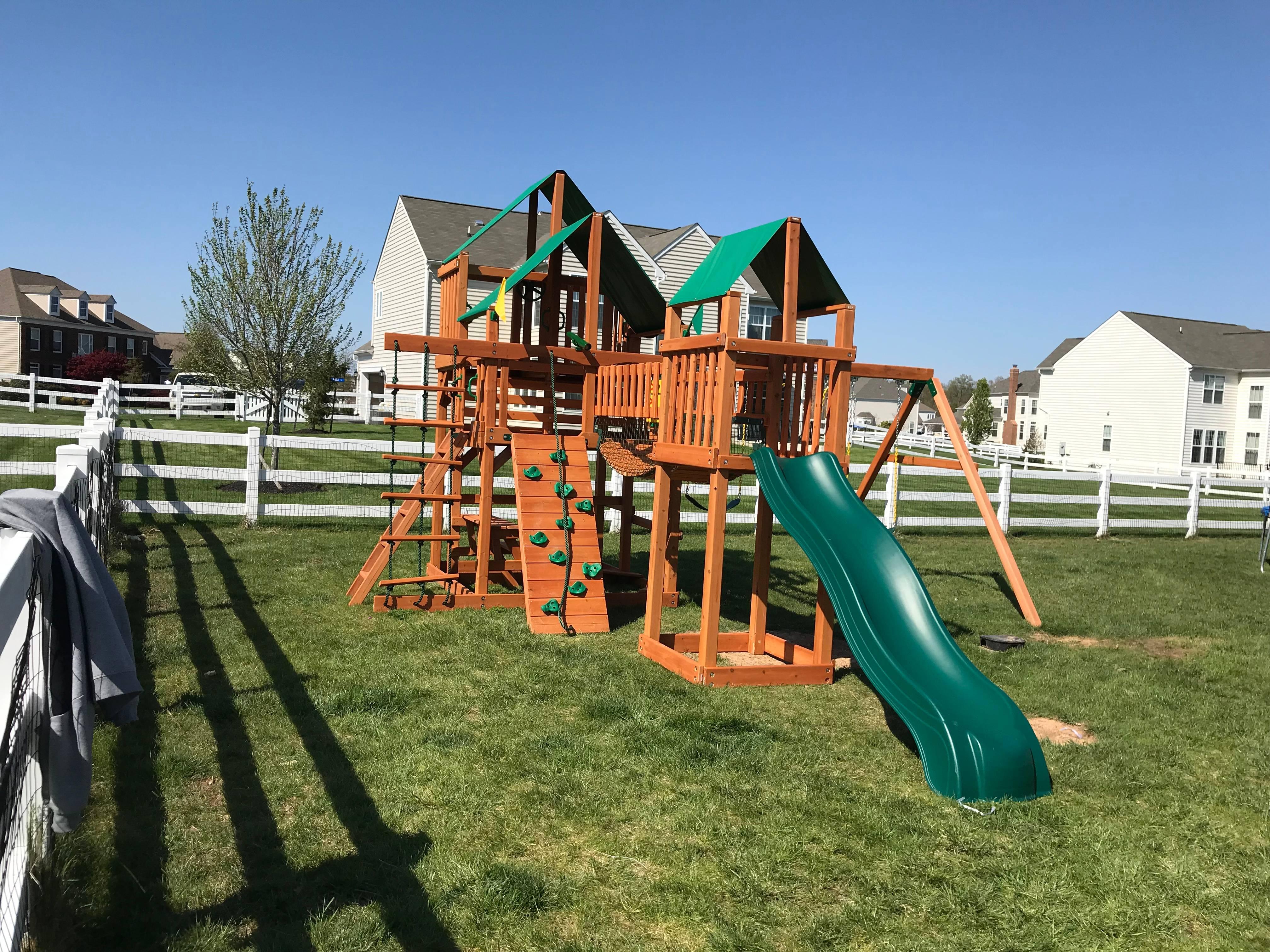 Gorilla treasure trove 1 cedar swing set installation in fairfax Virginia