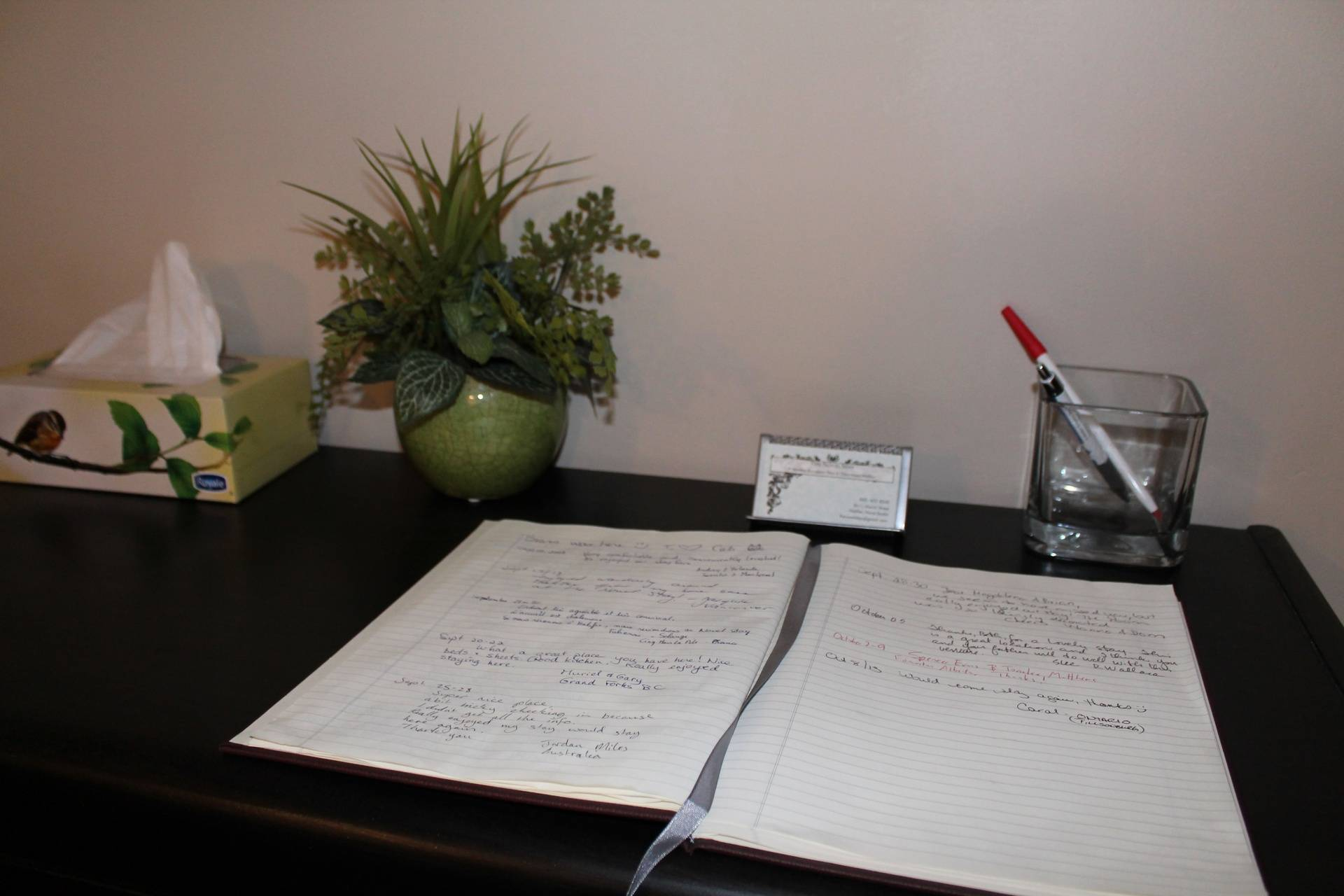 Front entrance with guest book and business cards