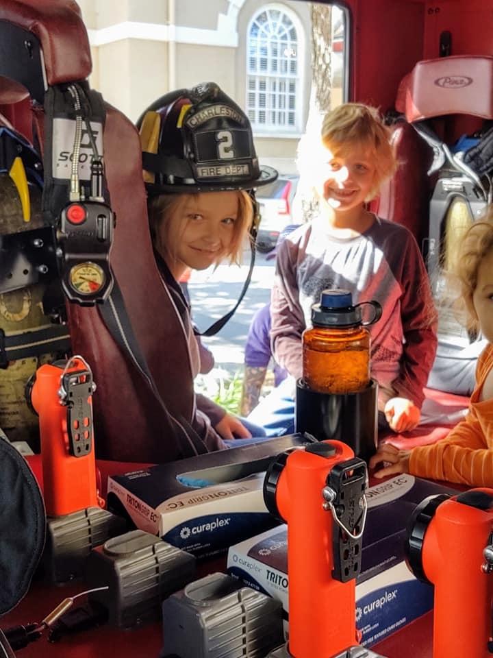 A peak inside the fire truck with helmet